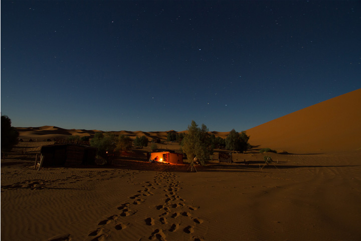 Desert camp at night.